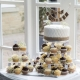 white and hessian cake with cupcakes surrounding