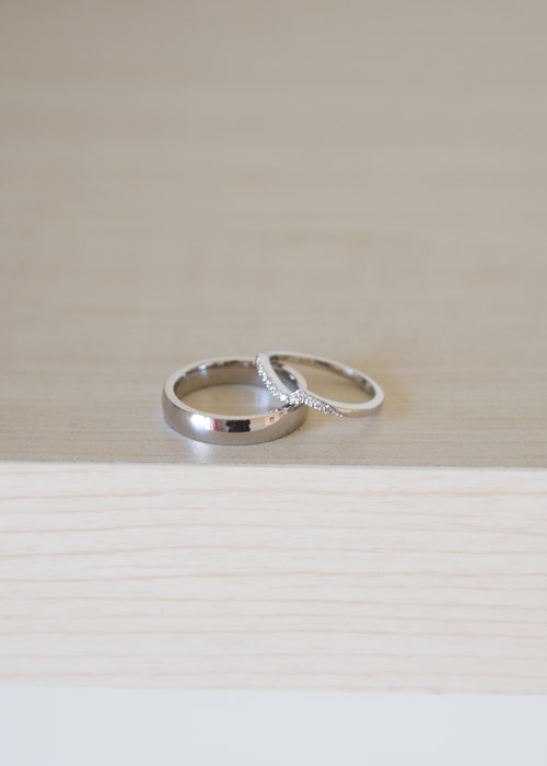 silver wedding bands on wooden backdrop