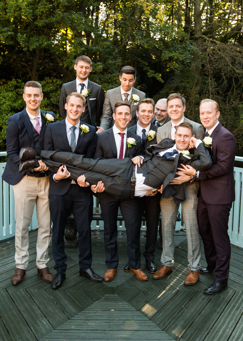groom and groomsmen holding groom up at whitley hall hotel sheffield
