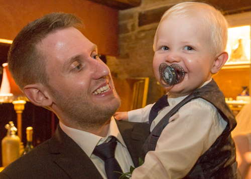 groom with son on the evening of the wedding