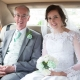 bride and father of the bride in the wedding car before the ceremony