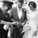 chauffer pouring bride and groom champagne on their wedding day