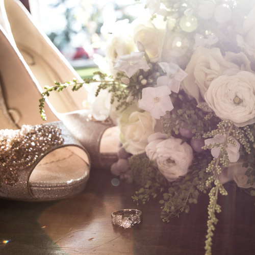 bridal shoes with brideal bouquet and wedding ring