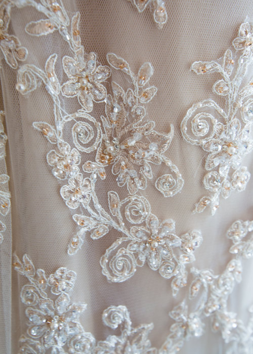 wedding dress detail with beading and lace