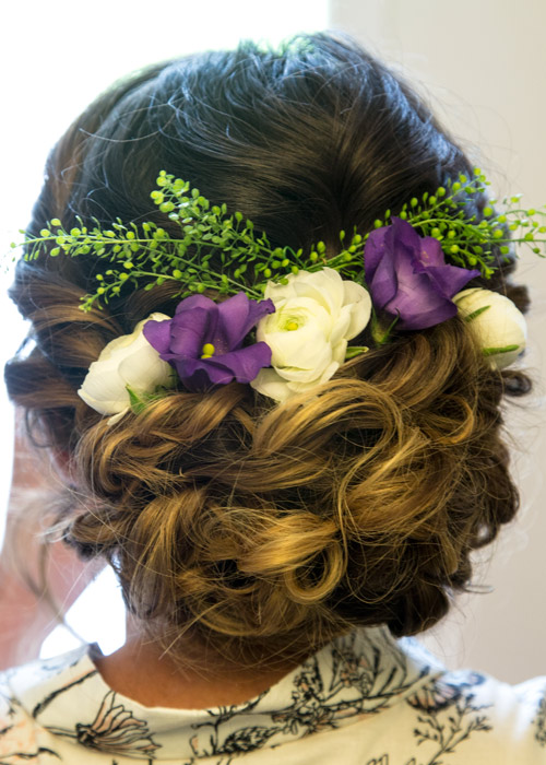 bridal hair with purple and white flowers