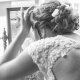 bride looking in mirror on the morning of the wedding balck and white