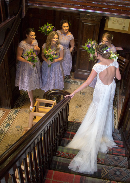 bridesmaids looking at bride walking down stairs at cubley hall penistone sheffield