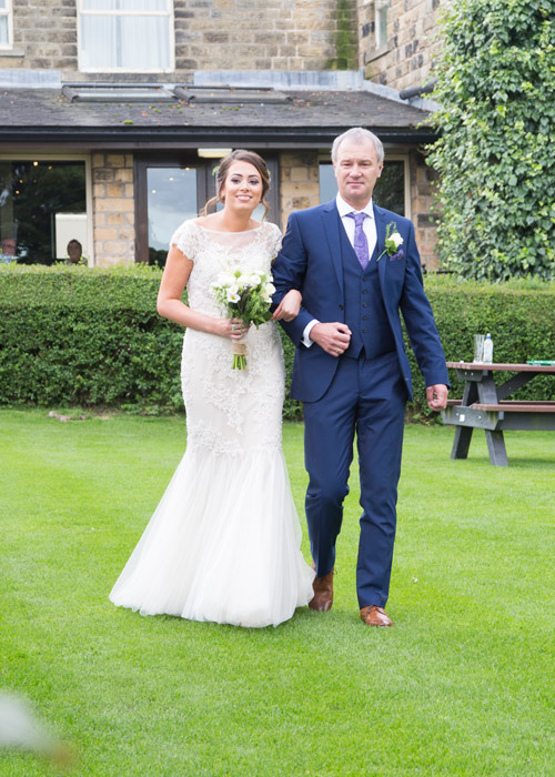 bride and father of the bride walking down the grass aisle cubley hall penistone sheffield
