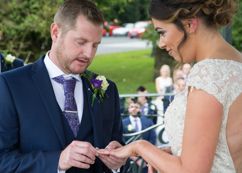 bride and groom in outside ceremony exchanging rings cubley hall penistone sheffield