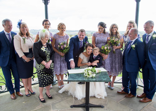 bride and groom with family signing register cubley hall penistone sheffield