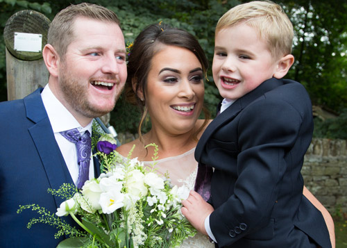 bride and groom laughing with their son cubley hall penistone sheffield