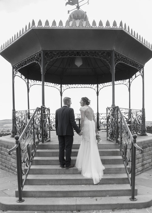 bride and groom walking up the steps to the bandstand cubley hall penistone sheffield