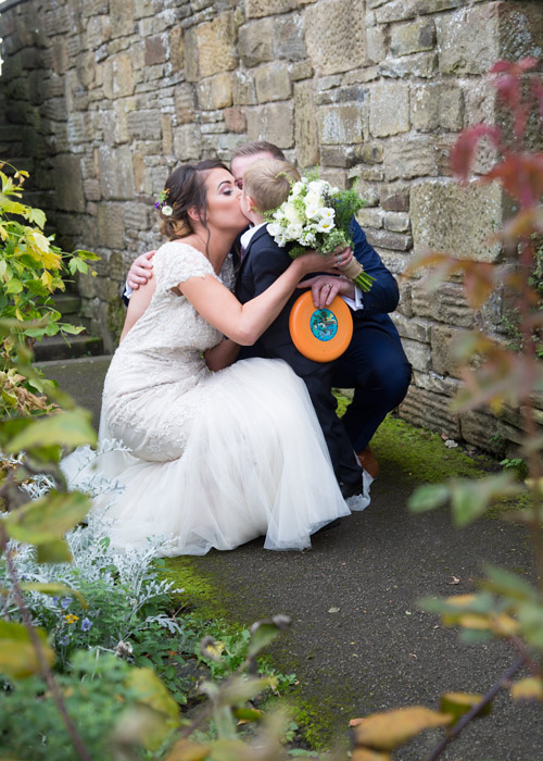 bride and groom kissing son with orange frizbee cubley hall penistone sheffield