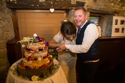 laughing while cutting the cake cubley hall penistone sheffield