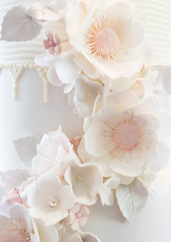 white and pink flower detail on elegant cake