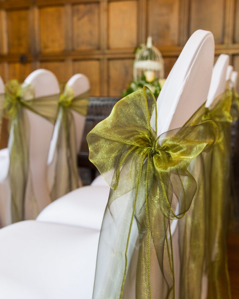 green bow on white chair cover in cannon hall ballroom barnsley