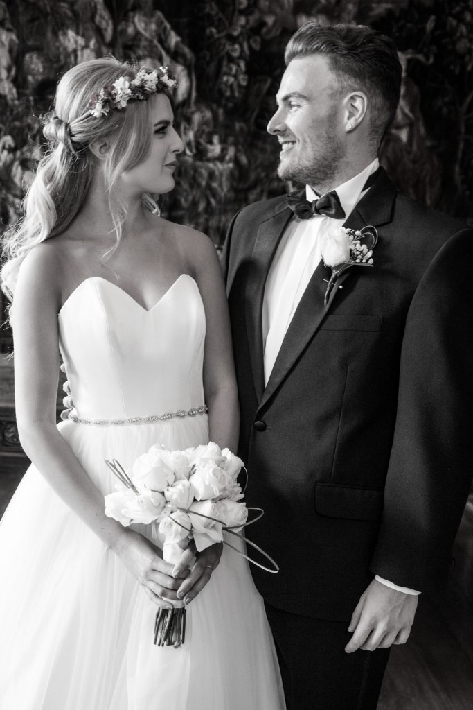 bride and groom looking at each other black and white