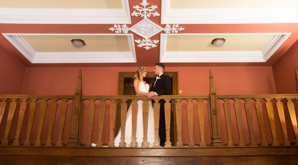bride and groom on the balcony in the ballroom at cannon hall cawthorne