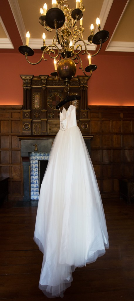bijou bridal dress hanging from chandelier in the ballroom of cannon hall museum barnsley
