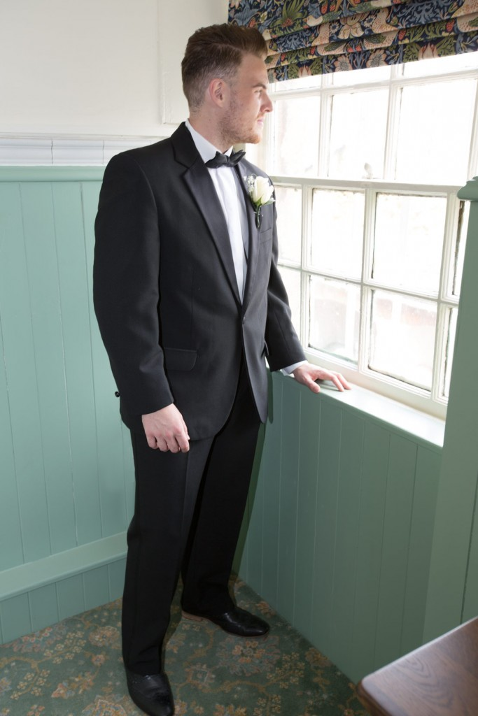 groom looking out of the butlers pantry at cannon hall