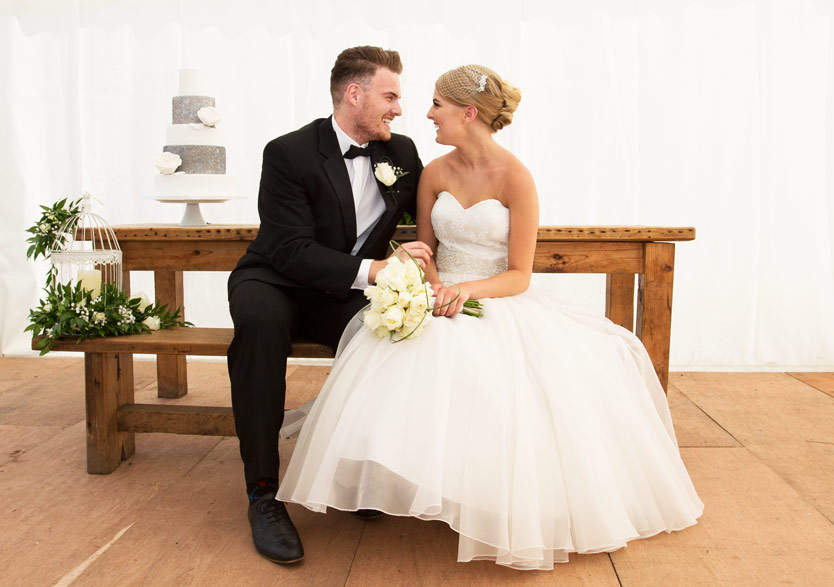 bride and groom laughing in the marquee at cannon hall gardens walled garden