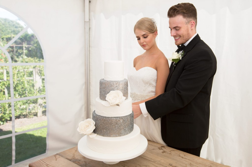 bride and groom cutting the cake at cannon hall museum