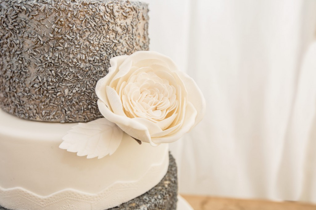 white flower on silver and white cake by booootiful cakes barnsley