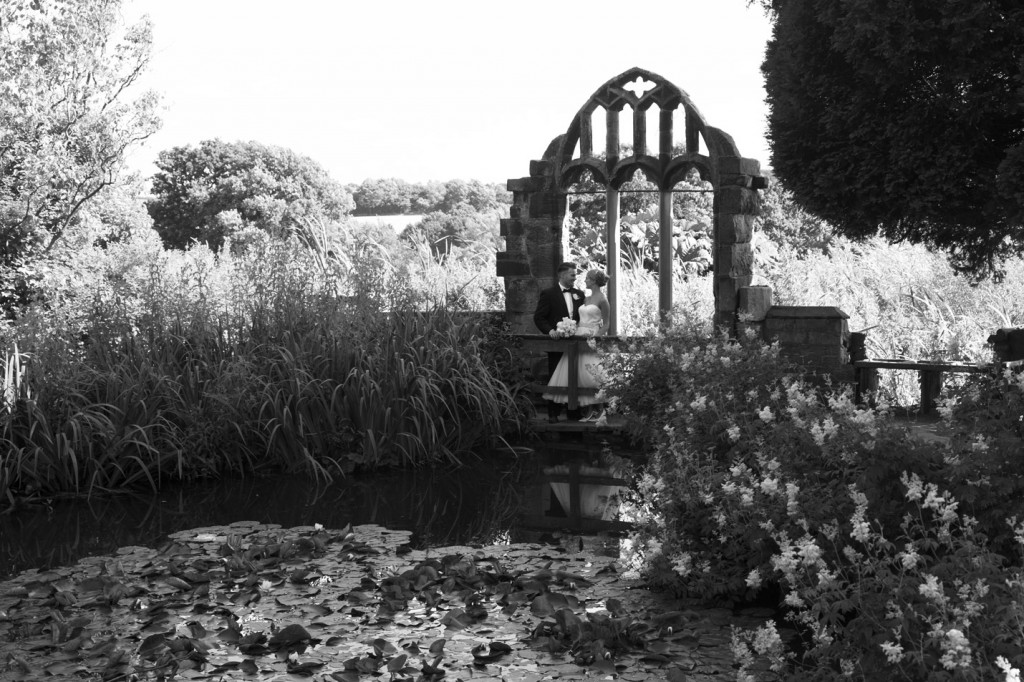 bride and groom on the bridge at fairyland in cannon hall park barnsley