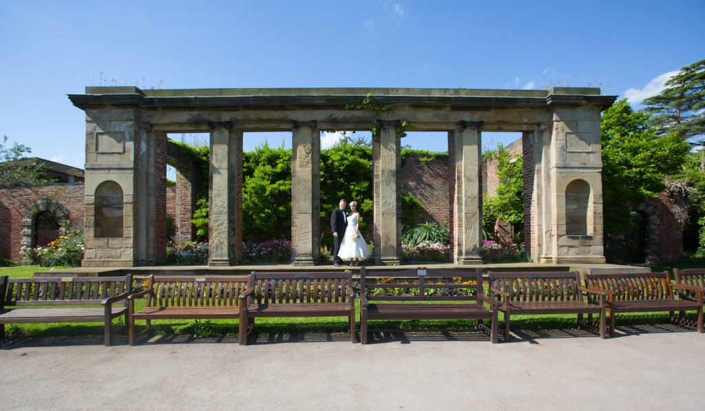bride and groom standing in front of the walled garden at cannon hall park and country garden cawthorne