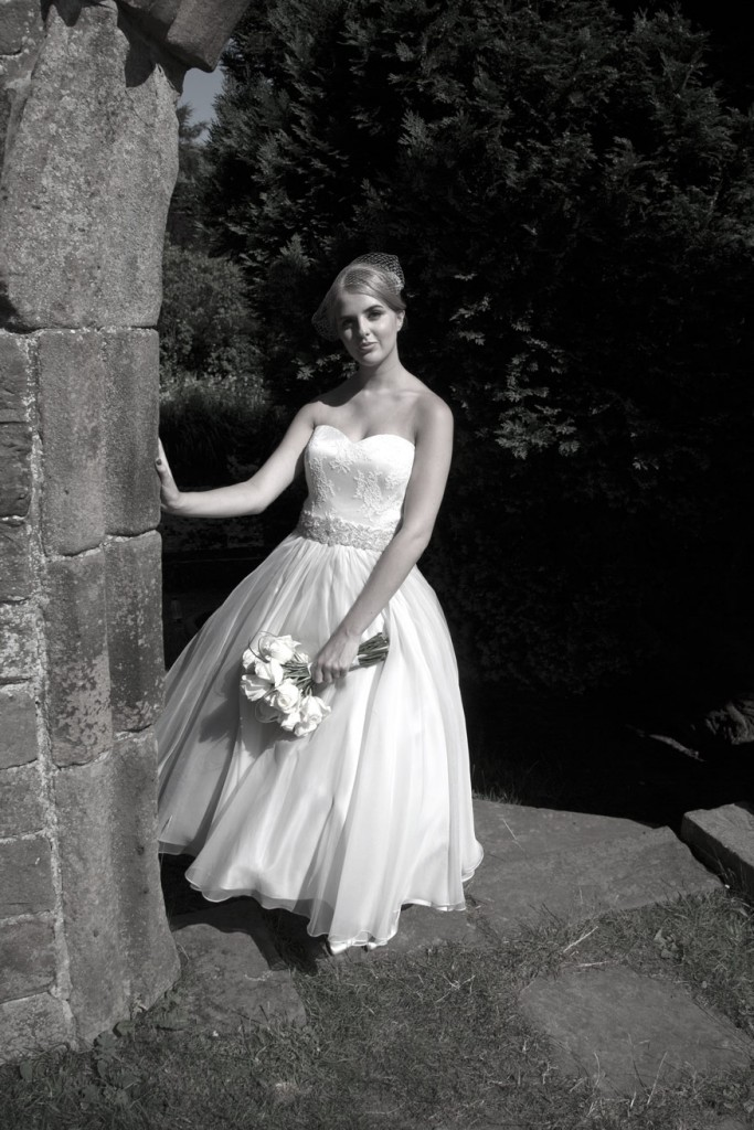black and white bride with bouquet in fairyland at cannon hall park barnsley