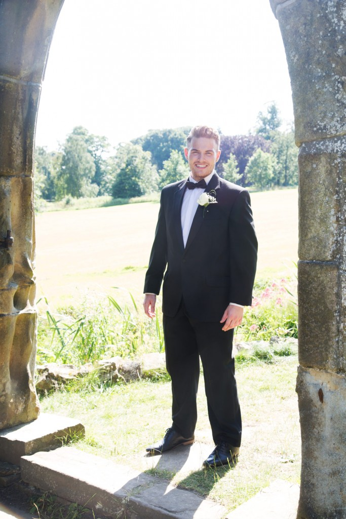 groom standing under archway at cannon hall park and country gardens barnsley