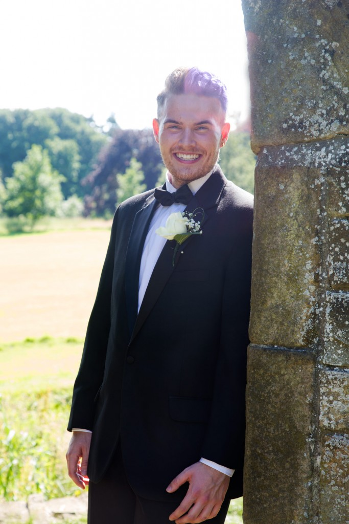 groom standing next to fairyland arch at cannon hall cawthorne