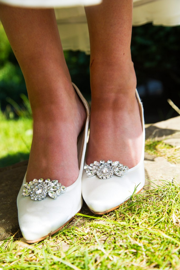 sparkle clips on ivory shoes standing on grass