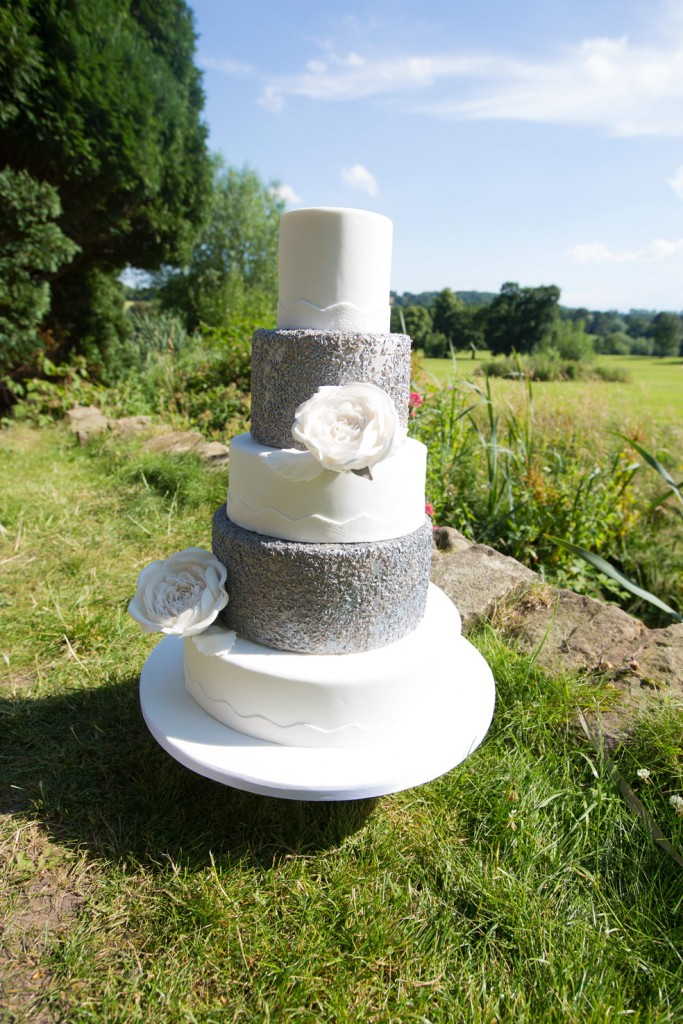 White and silver cake in cannon hall grounds