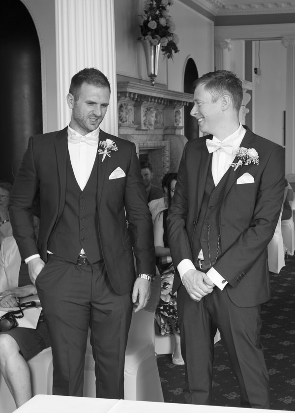groom and best man talking in the ceremony room the stables high melton doncaster