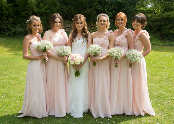 bridesmaids in pink dresses with bride the stables high melton doncaster
