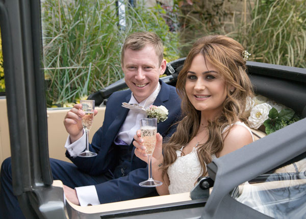 bride and groom in wedding car with champagne the stables high melton doncaster