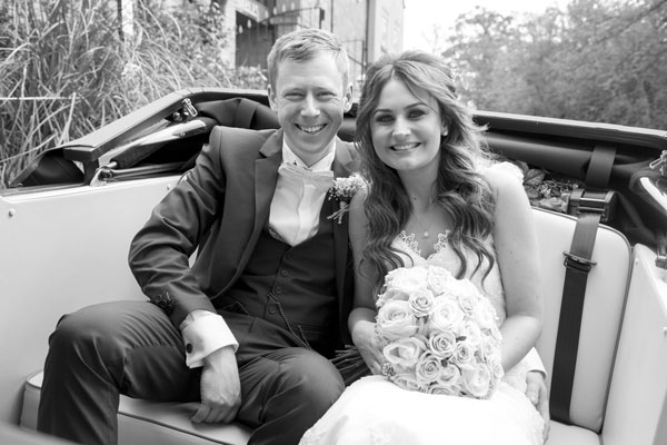 black and white bride and groom in wedding car the stables high melton doncaster