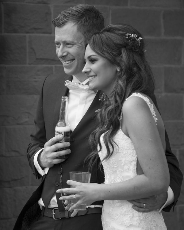 bride and groom smiling together the stables high melton doncaster