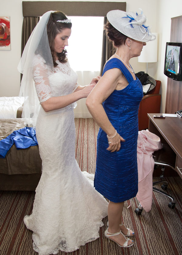 bride fastening mothers blue dress holiday inn barnsley