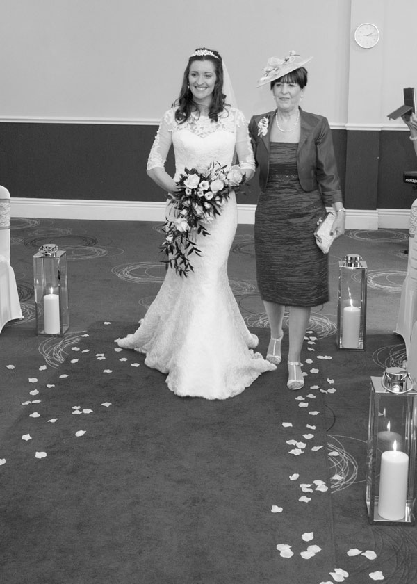 mother of the bride walking down the aisle with candles and petals holiday inn barnsley