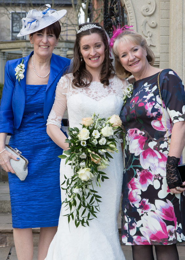 bride with mothers outside holiday inn barnsley secret garden