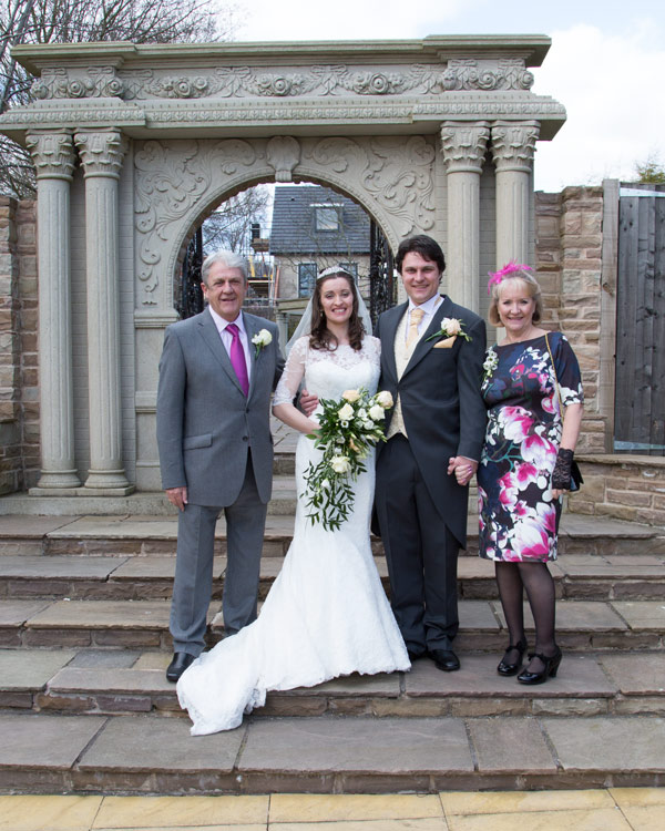 couple with grooms parents outside holiday inn barnsley secret garden