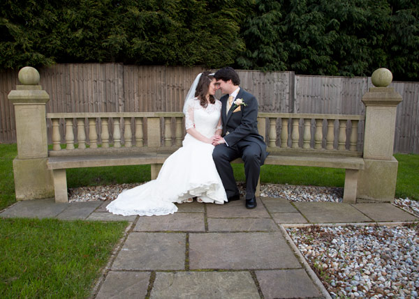 bride and groom holding hands and touching foreheads in holiday inn barnsley secret garden
