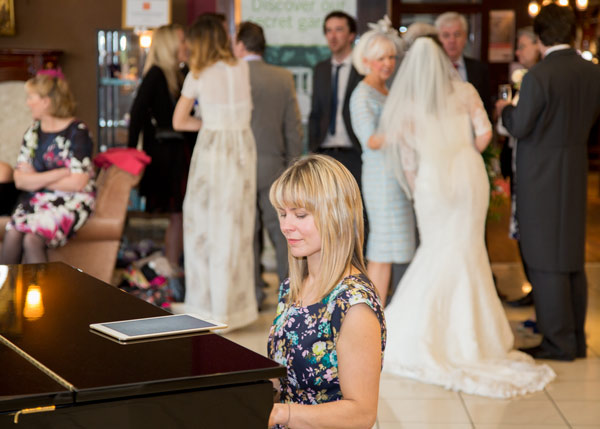 catherine rannus pianist with wedding in background holiday inn barnsley