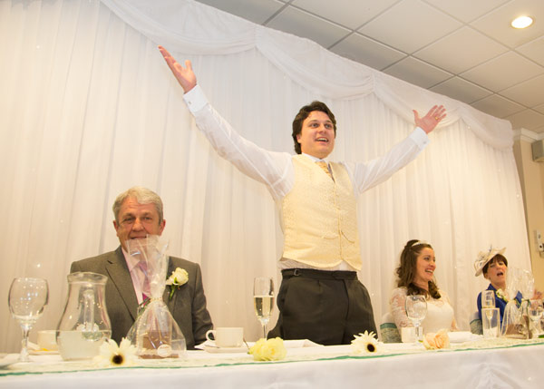 groom making a speech with outspread arms holiday inn barnsley