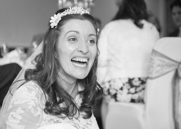 bride laughing with daisy in her hair holiday inn barnsley black and white