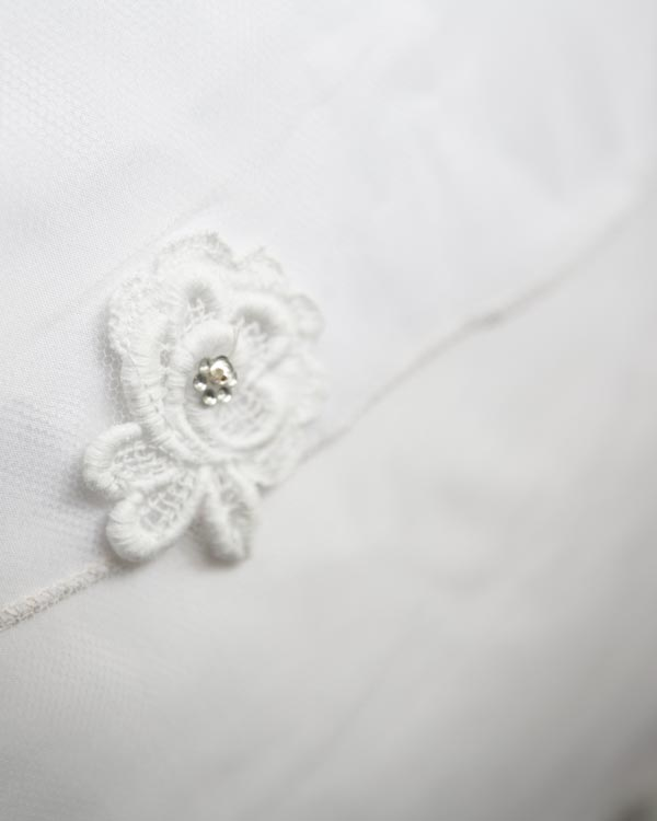 lace flower with sparkle in center on veil