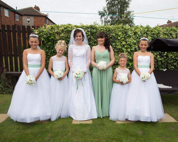 bride and bridesmaids in mint green dresses