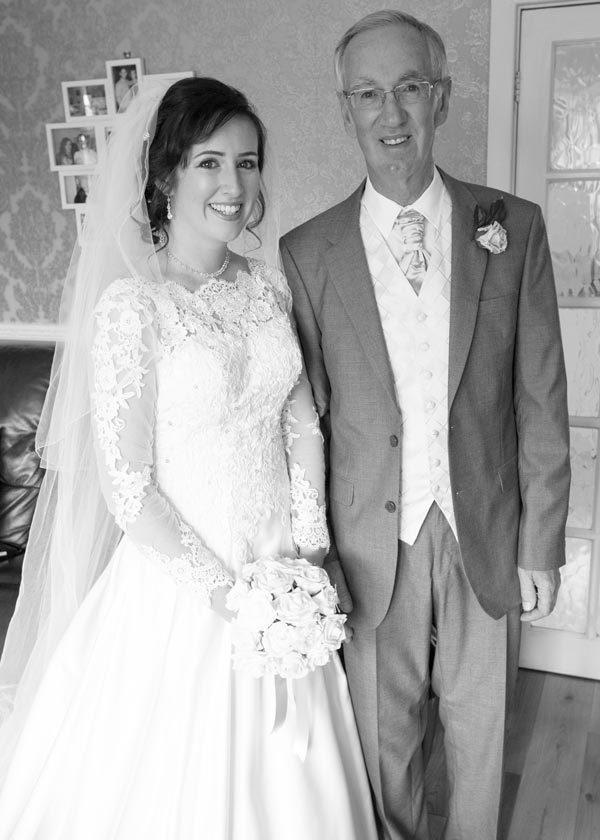 bride and father of the bide waiting to leave for the church black and white